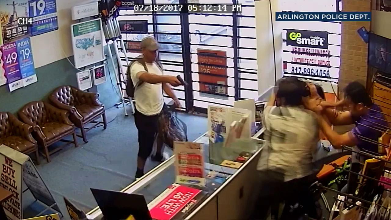 A cellphone store owner and his son fought off armed robbers in Arlington, Texas.