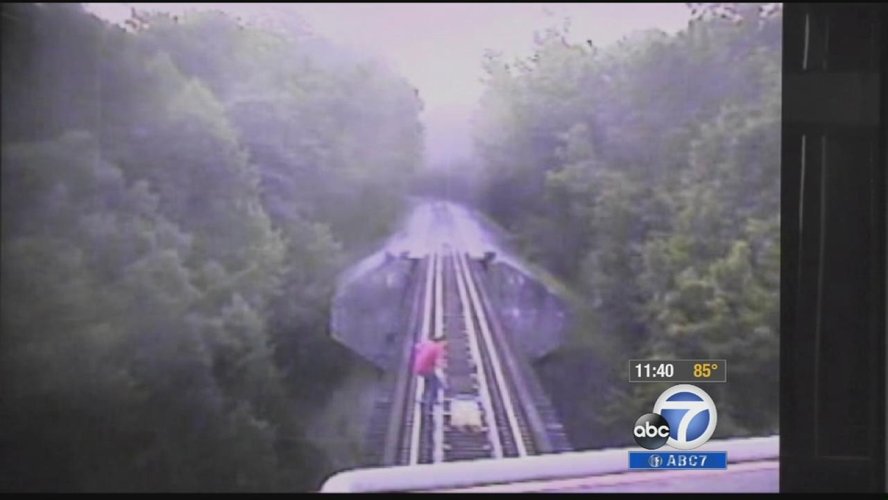 Two women were nearly killed by a train on an Indiana railroad bridge, and their brush with death was caught on camera.