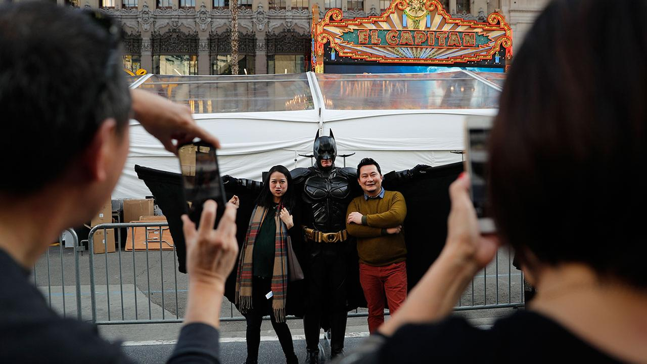 In this Thursday, March 2, 2017 photo, superhero impersonator Matthias Balke poses with tourists on Hollywood Boulevard near the Dolby Theatre in Los Angeles.Jae C. Hong