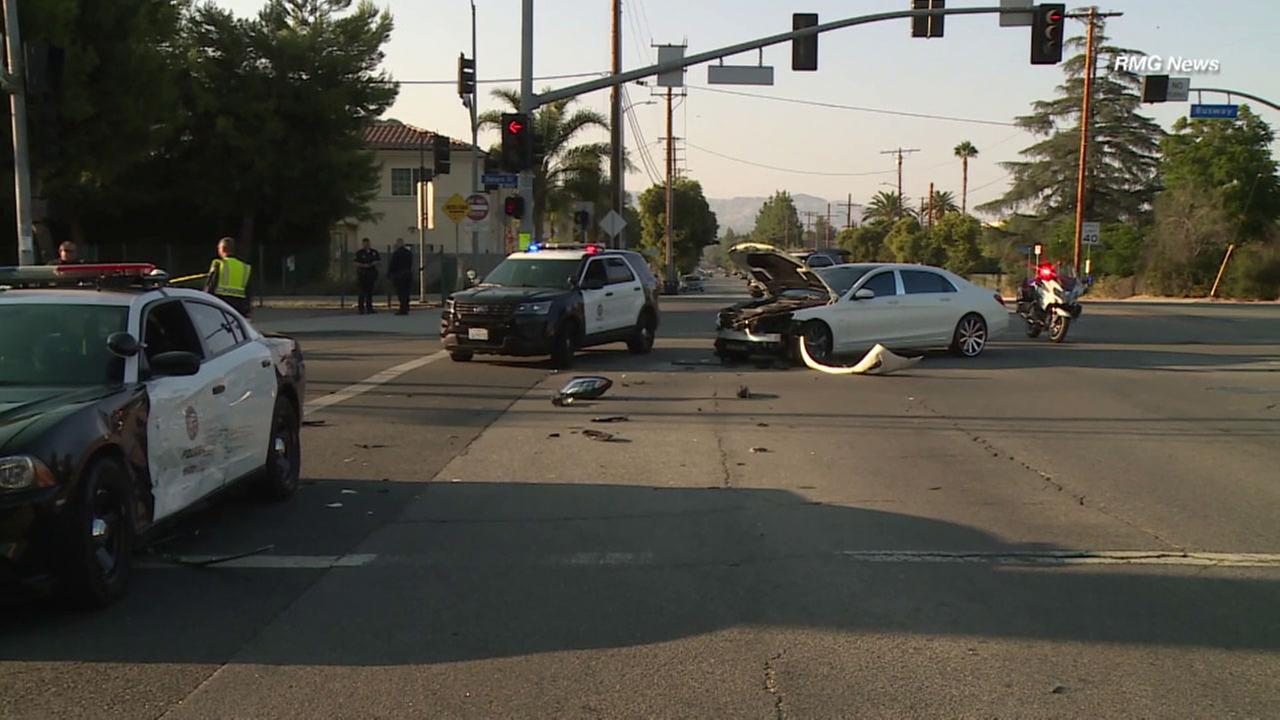 A Los Angeles police cruiser and a Maybach sedan collided at a Tarzana intersection on Sunday, officials said.