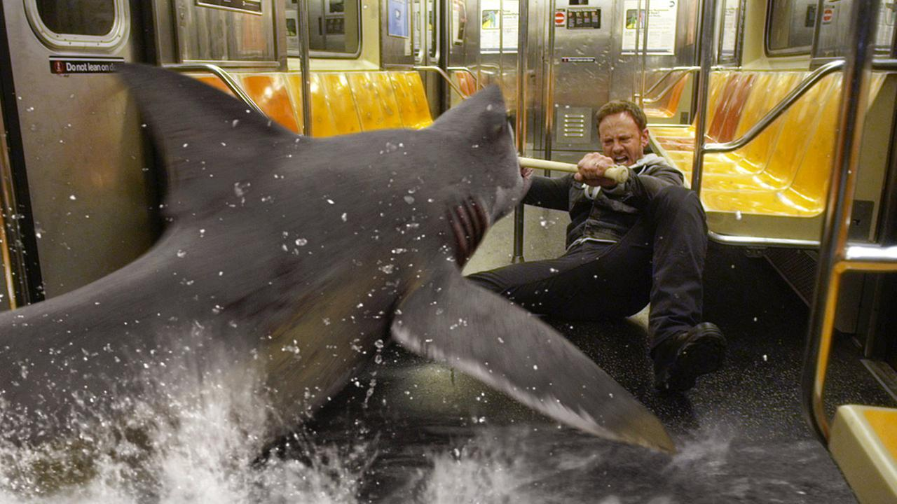 In this image released by Syfy, Ian Ziering, as Fin Shepard, battles a shark on a New York City subway in a scene from Sharknado 2: The Second One.