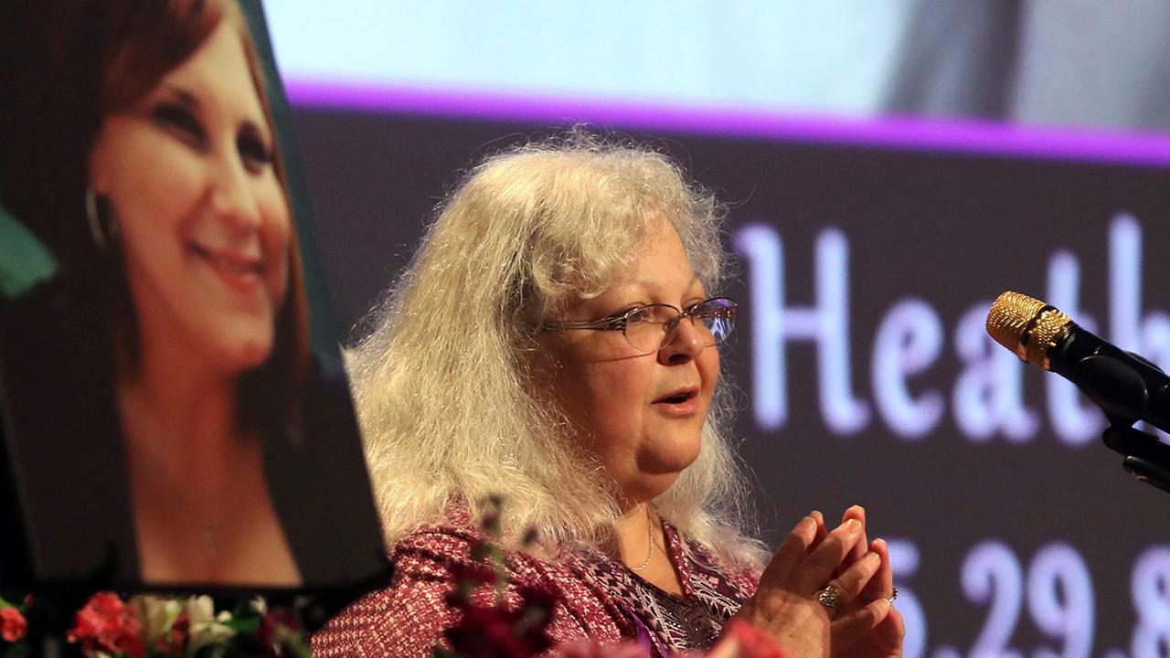 Susan Bro, mother to Heather Heyer, speaks during a memorial for her daughter, Wednesday, Aug. 16, 2017, at the Paramount Theater in Charlottesville, Va.