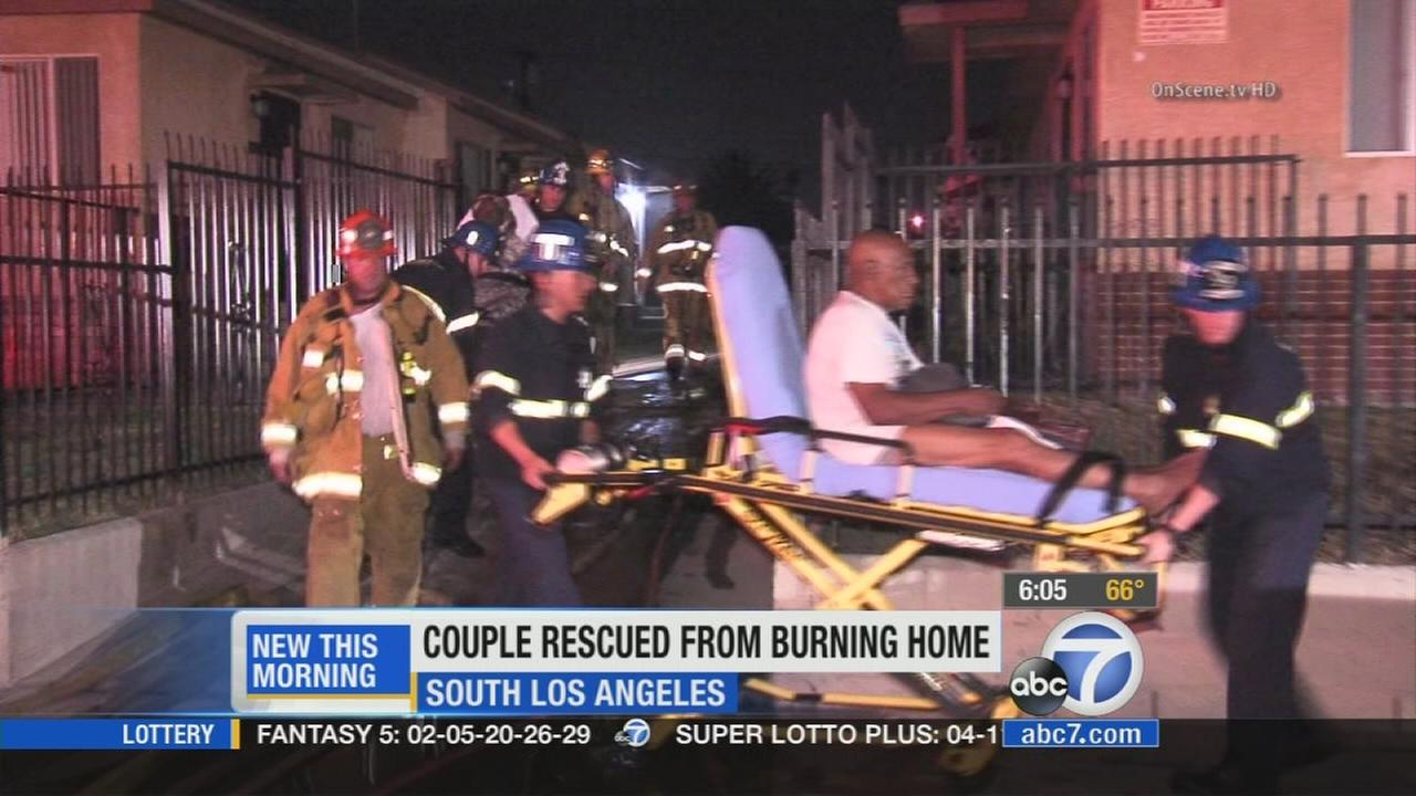 Los Angeles County sheriffs deputies arrived at a South Los Angeles home just in time to rescue an elderly couple from their burning home.