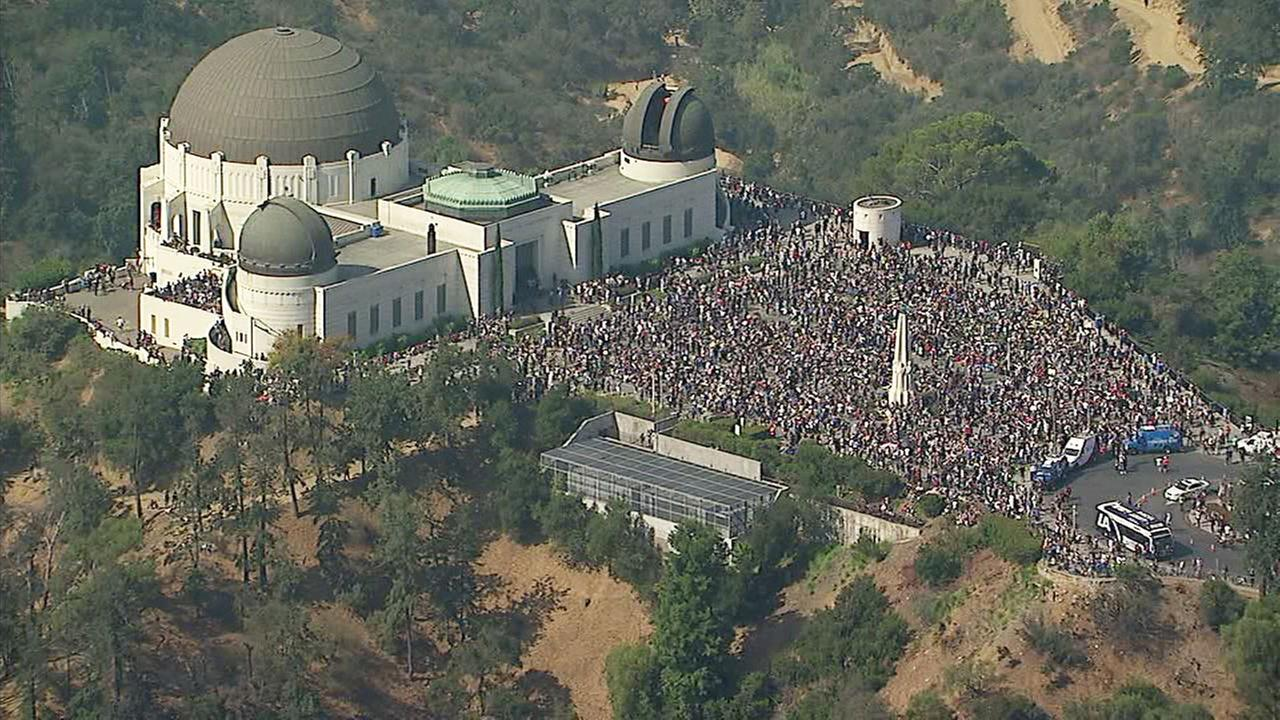 Large crowds of people seen watching the solar eclipse at Griffith Observatory on Monday, Aug. 21, 2017.
