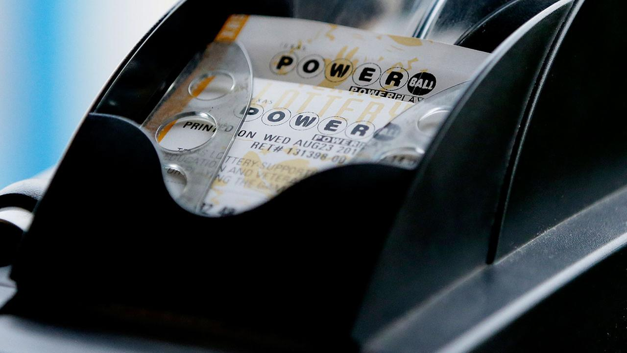 A Powerball lottery ticket is printed on a lottery machine at a convenience store in Dallas Wednesday, Aug. 23, 2017.