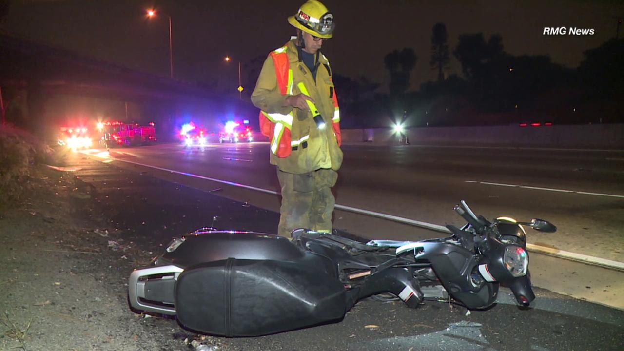A Los Angeles County firefighter stands over a wrecked motorcycle after a fatal crash southbound 405 Freeway in Inglewood on Friday, Aug. 25, 2017.