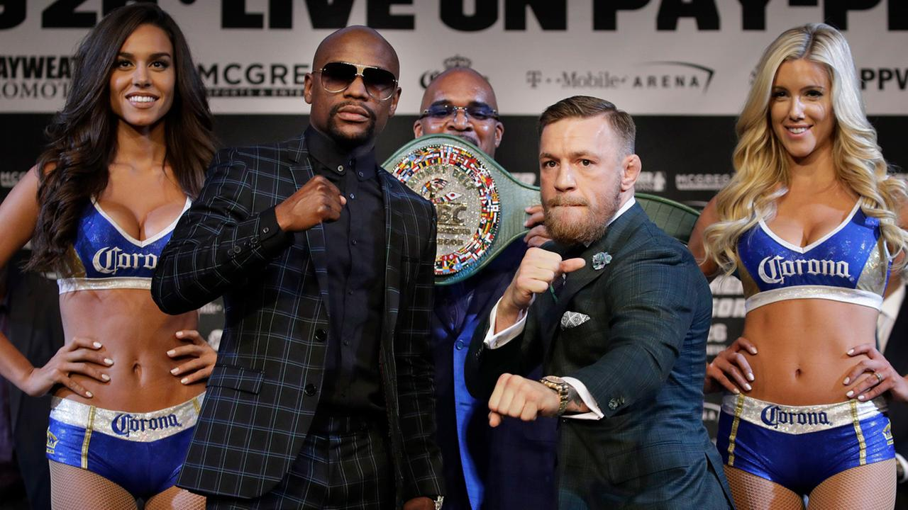 Floyd Mayweather Jr., left, and Conor McGregor pose for photographers during a news conference Wednesday, Aug. 23, 2017, in Las Vegas.