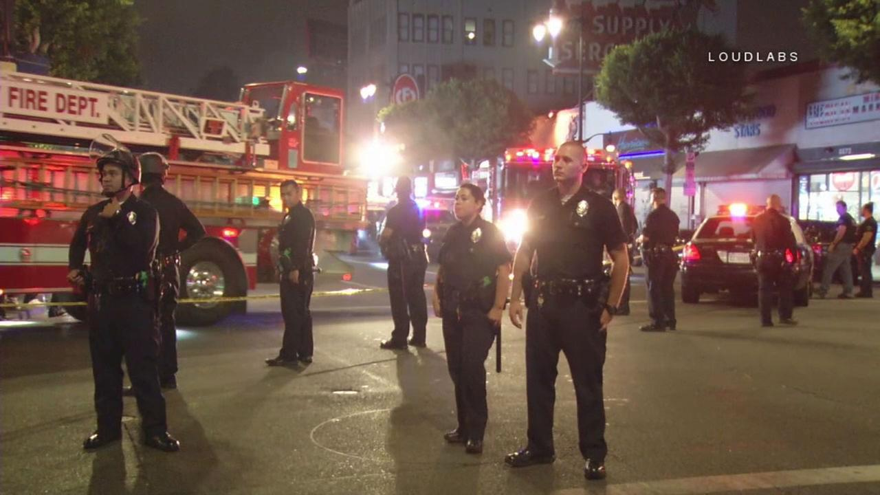 Los Angeles police surround a crowd at the scene of a shooting on Hollywood Boulevard on Sunday, Aug. 27, 2017.
