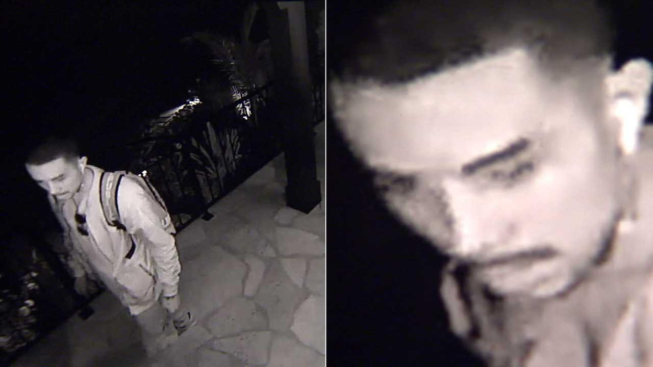 A prowler is seen roaming a Miracle Mile property in home surveillance video.