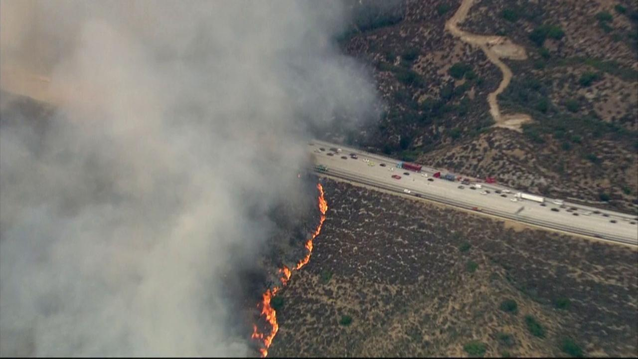 A brush fire is spreading rapidly along the 210 Freeway in Sun Valley on Friday, Sept. 1, 2017.