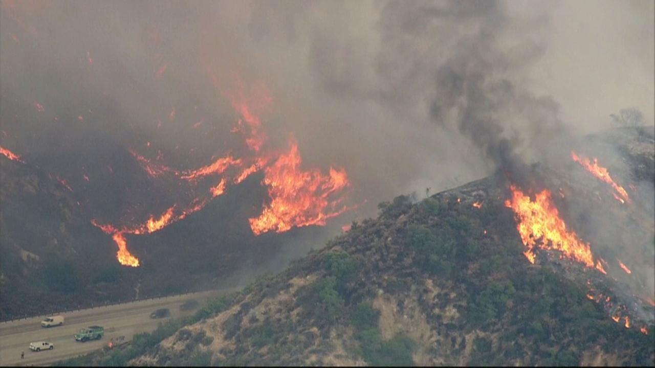The La Tuna Canyon Fire burns dangerously close to the 210 Freeway in Sun Valley on Friday, Sept. 1, 2017.