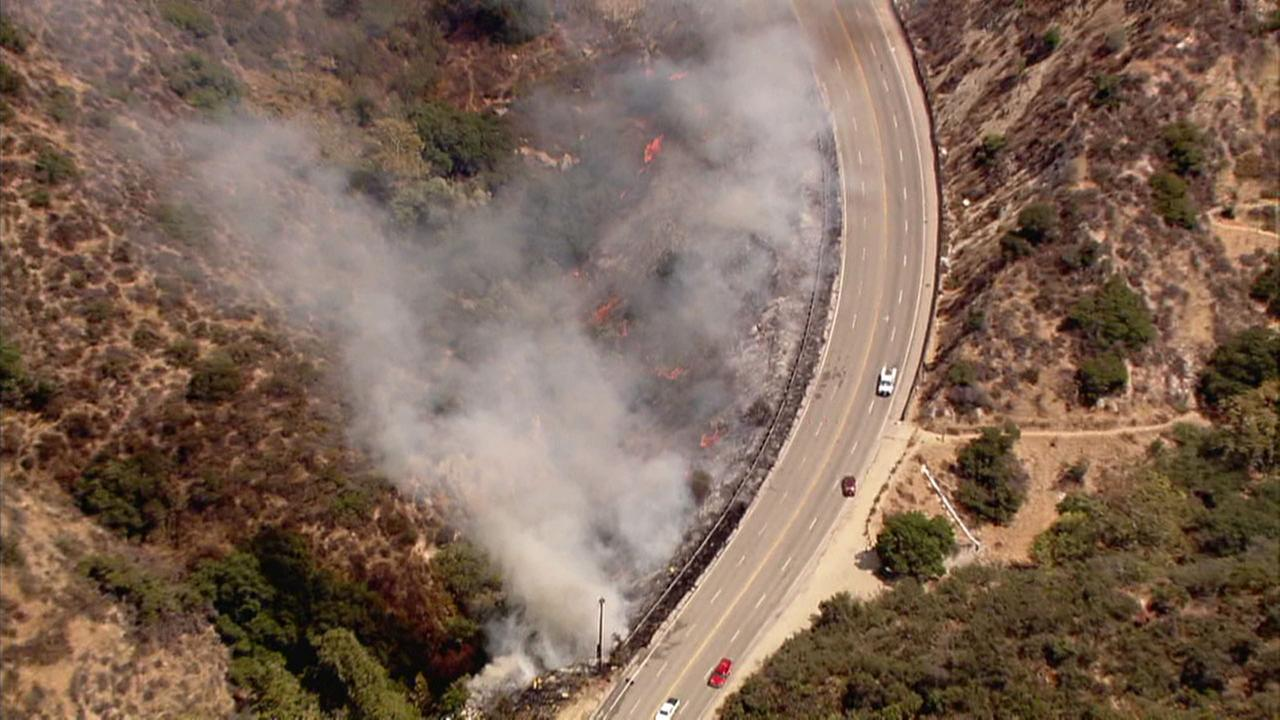 A brush fire begins to spread along the 210 Freeway in Sun Valley on Friday, Sept. 1, 2017.