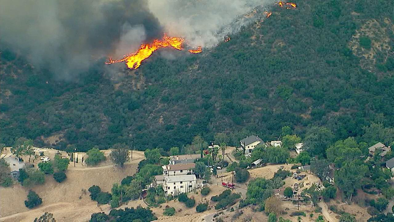 Flames are threatening homes in neighborhoods north of the 210 Freeway in Sun Valley.