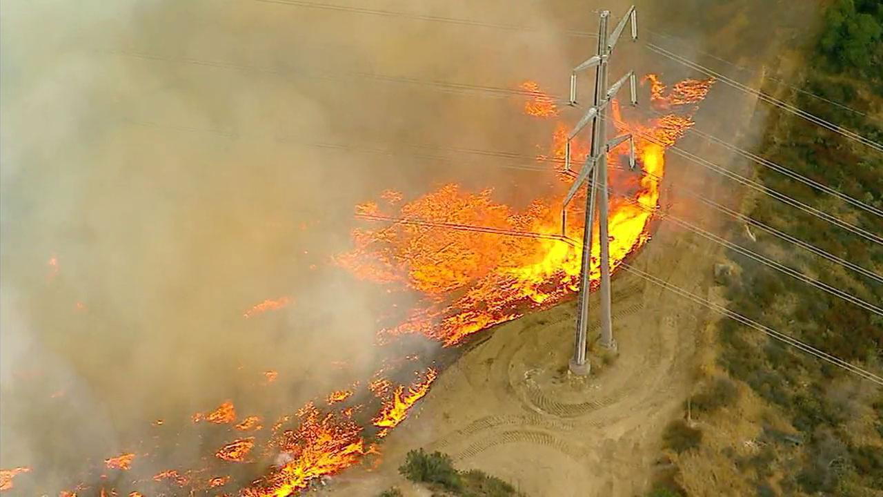 Flames are threatening power lines in Sun Valley.