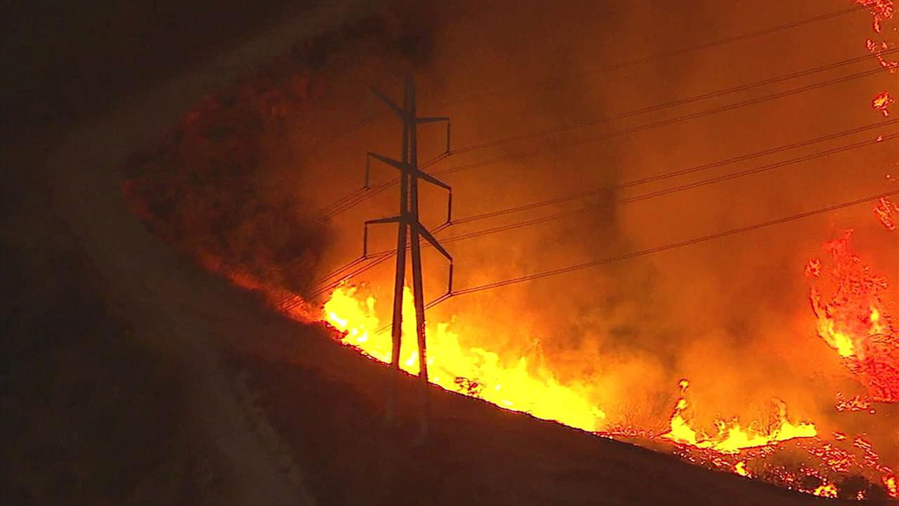 The La Tuna Fire burned at least 1,500 acres and was expected to continue through the night.