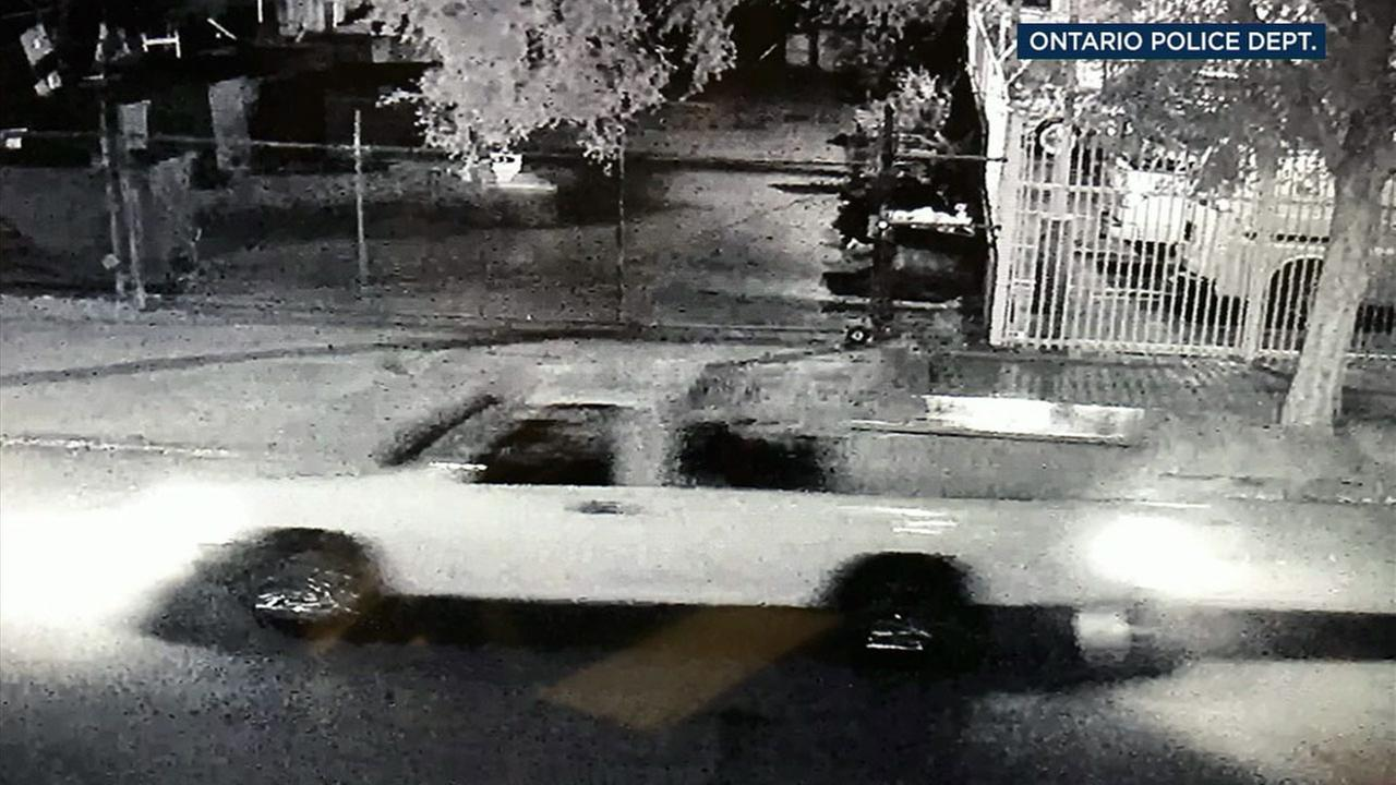 Surveillance video shows a white truck driving down a street in Ontario with a refrigerator in the bed.