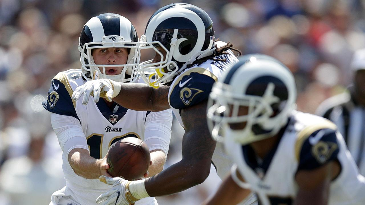 Rams quarterback Jared Goff, left, hands off to running back Todd Gurley during LAs 46-9 win over the Indianapolis Colts on Sunday, Sept. 10, 2017 at the Coliseum.
