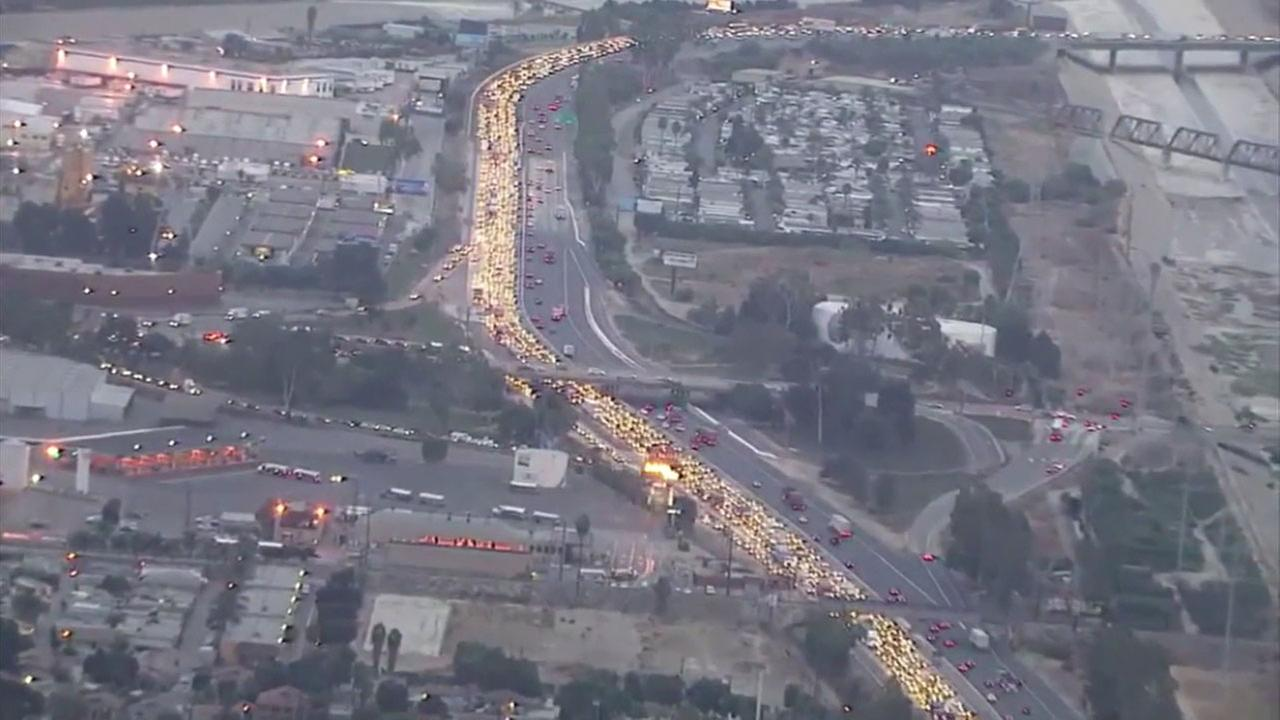 Traffic is shown backing up on a Southern California freeway.