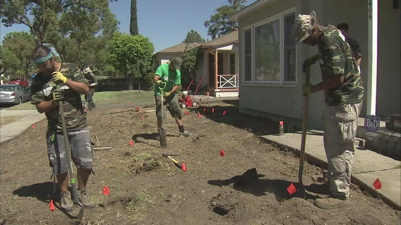 Turf Terminators workers work on a drought-tolerant yard.