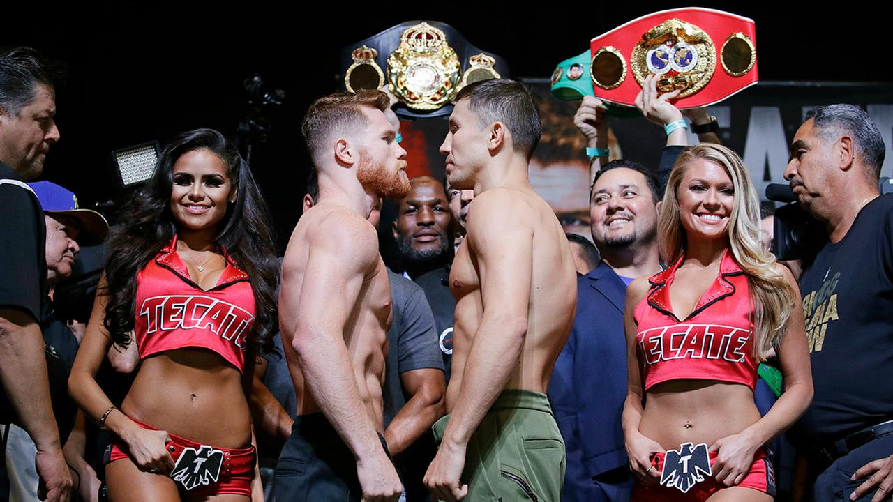 Canelo Alvarez, center left, and Gennady Golovkin pose during a weigh-in Friday, Sept. 15, 2017, in Las Vegas. The two are scheduled to fight in a middleweight title fight.