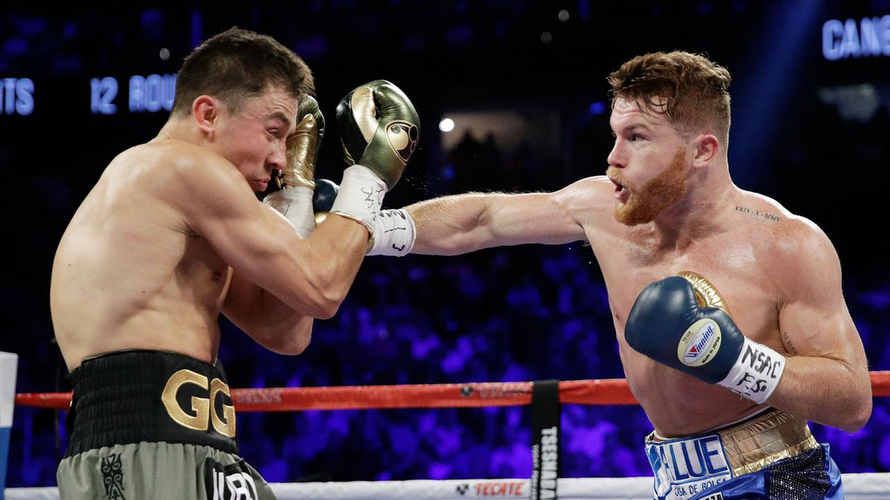 Canelo Alvarez, right, throws a right at Gennady Golovkin during a middleweight boxing bout Saturday, Sept. 16, 2017, in Las Vegas.
