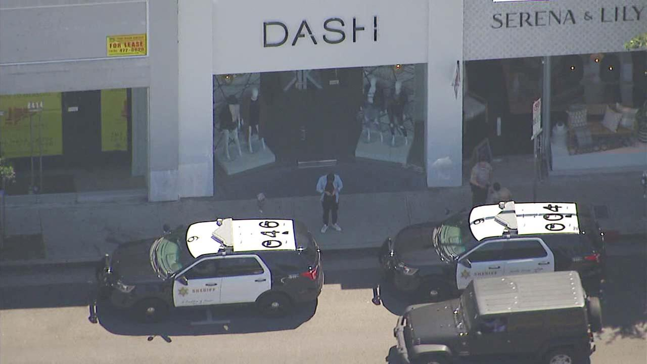 Law enforcement officials are seen at the Kardashians Dash store in West Hollywood on Thursday, Sept. 21, 2017.
