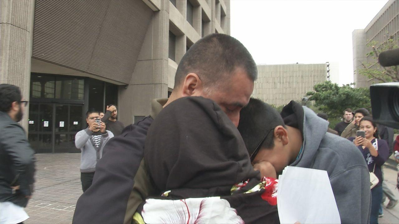 A Huntington Beach man who was arrested by ICE agents hugged his children as he got word that his deportation hearing was delayed by a month.