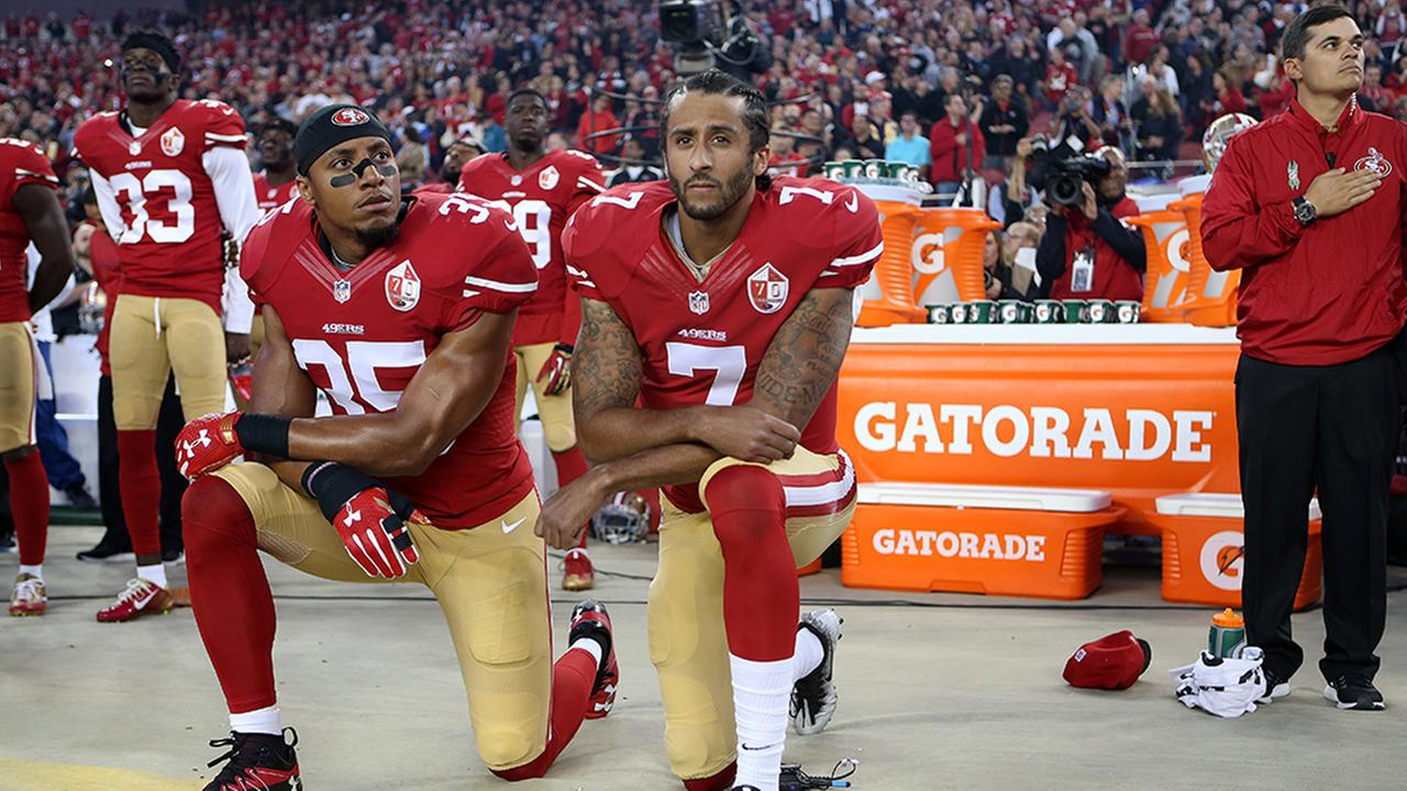 San Francisco 49ers Eric Reid (35) and Colin Kaepernick (7) take a knee during the National Anthem prior to their season opener against the Los Angeles Rams.