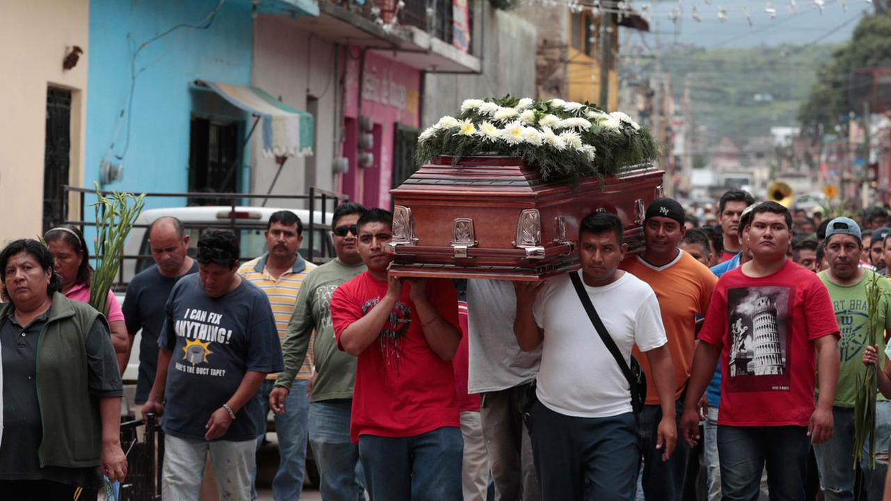 Locals carry the casket of a woman who died in Tuesdays earthquake, in Tlayacapan, Morelos state, Mexico, Wednesday, Sept. 20, 2017.