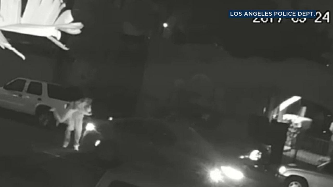 Surveillance video caught what appeared to be a woman kidnapped off a South Los Angeles street.