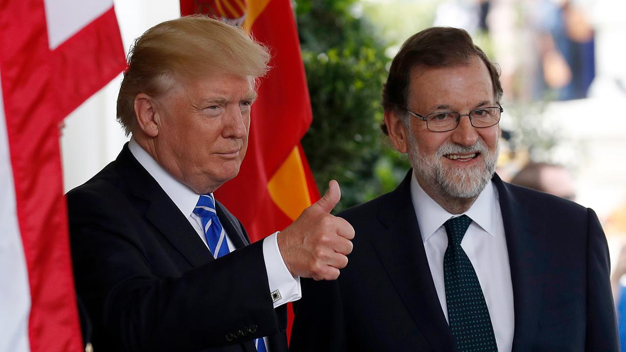 President Donald Trump gives thumbs up as he welcomes Spanish Prime Minister Mariano Rajoy at the White House, Tuesday, Sept. 26, 2017, in Washington.