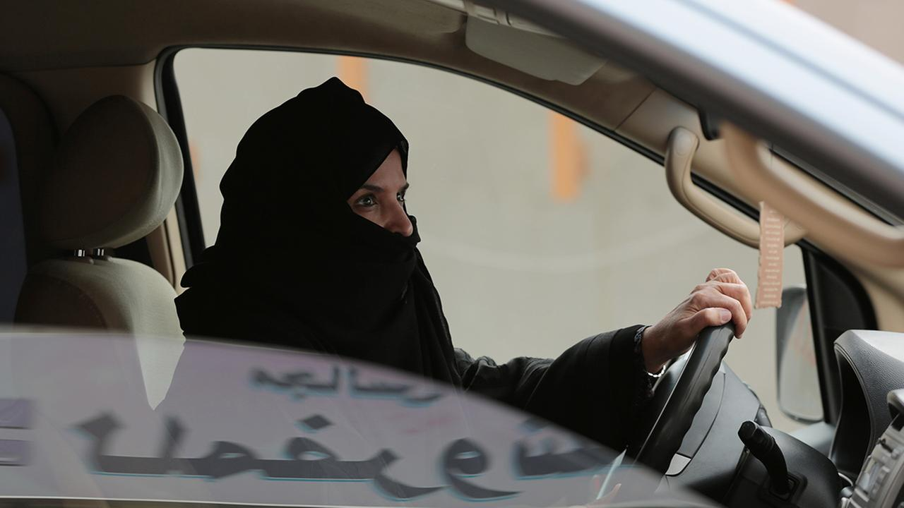 In this Saturday, March 29, 2014, file photo, Aziza Yousef drives a car on a highway in Riyadh, Saudi Arabia, as part of a campaign to defy Saudi Arabias ban on women driving.