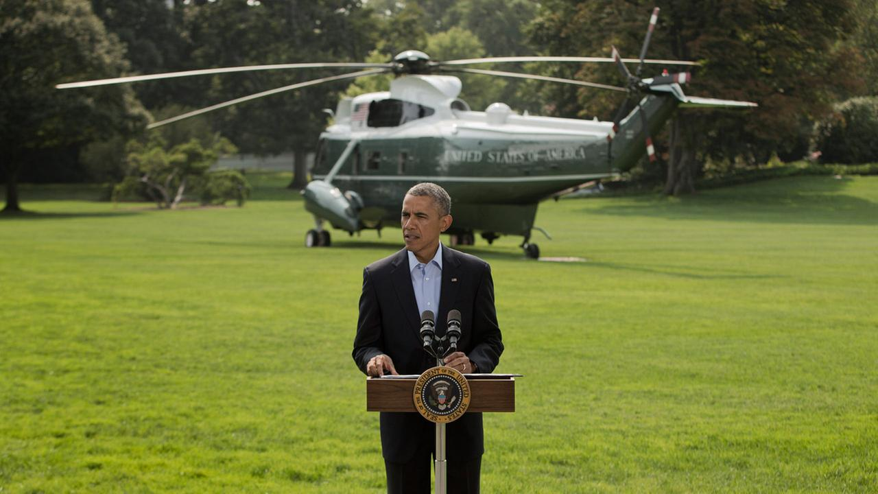 President Barack Obama speaks on the South Lawn of the White House in Washington, Saturday, Aug. 9, 2014, about ongoing situation in Iraq.