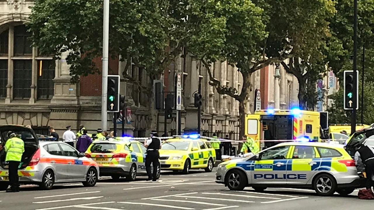 Emergency services are seen outside the Natural History Museum in London after reports that a car struck pedestrians on Saturday, Oct. 7, 2017.