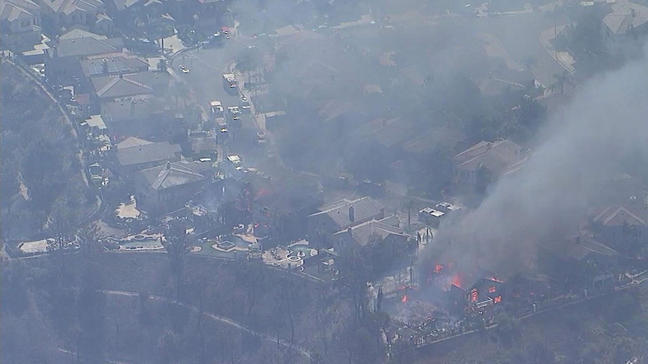 Several homes in an Anaheim Hills neighborhood went up in flames Monday as a brush fire burned.