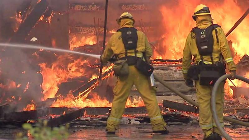 <div class='meta'><div class='origin-logo' data-origin='KABC'></div><span class='caption-text' data-credit=''>Firefighters work to extinguish flames consuming a home near Serrano Avenue in Anaheim Hills after a brush fire caught it ablaze.</span></div>