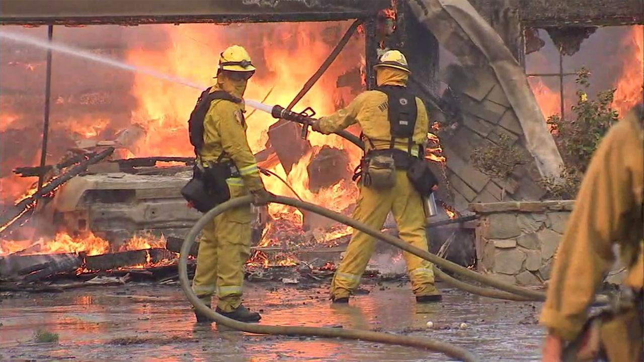 A home near Serrano Drive in Anaheim Hills was completely consumed with fire, including its garage.