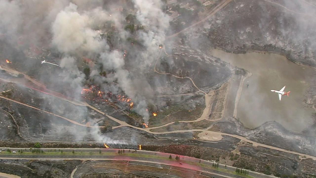 Thousands of acres of scorched earth could be seen from the air as firefighters worked to contain the Canyon Fire 2 burning near Anaheim Hills.