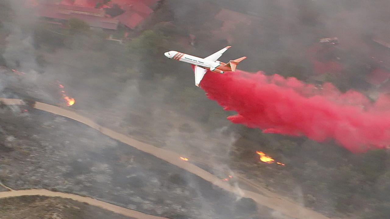 A jet carrying fire retardant dropped the flame-dampening substance on the Canyon Fire 2.