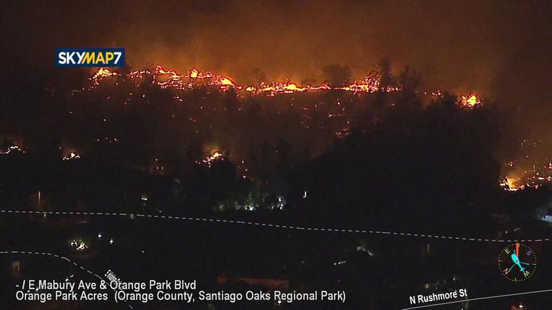 <div class='meta'><div class='origin-logo' data-origin='KABC'></div><span class='caption-text' data-credit=''>Flames burn along an Orange neighborhood as the Canyon Fire 2 continues to burn on Monday, Oct. 9, 2017.</span></div>