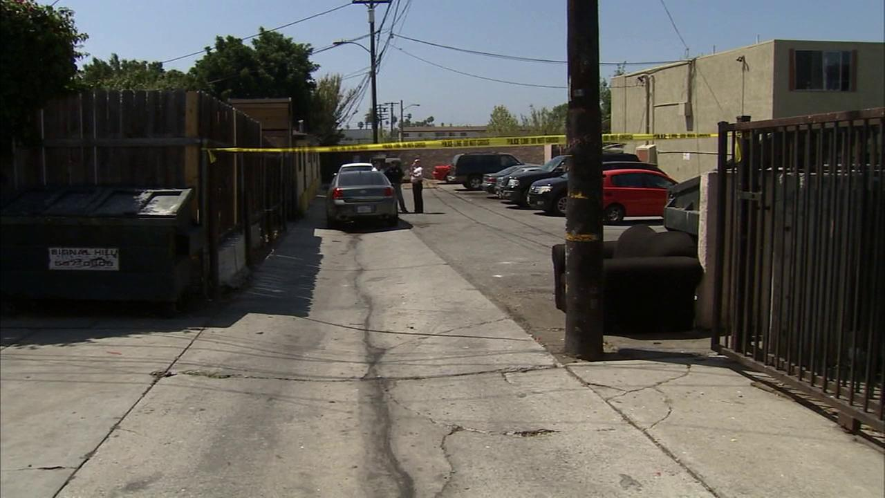 Authorities investigate the death of a 2-year-old boy in Signal Hill on Sunday, Aug. 10, 2014.