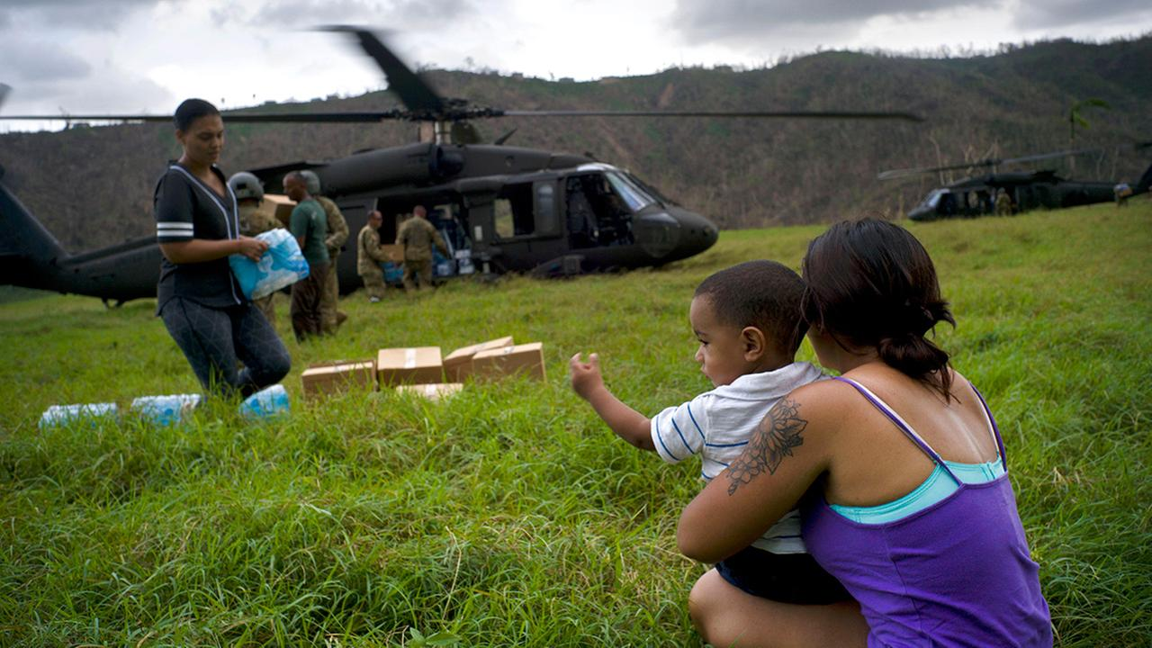 The Puerto Rican National Guard delivers food and water brought via helicopter to victims of Hurricane Maria, to the San Lorenzo neighborhood of Morovis, Puerto Rico.
