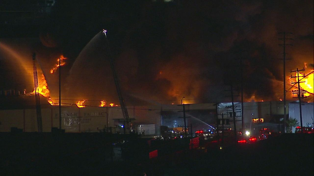Firefighters battled a large blaze inside a fabric warehouse in Boyle Heights on Saturday, Oct. 14, 2017.