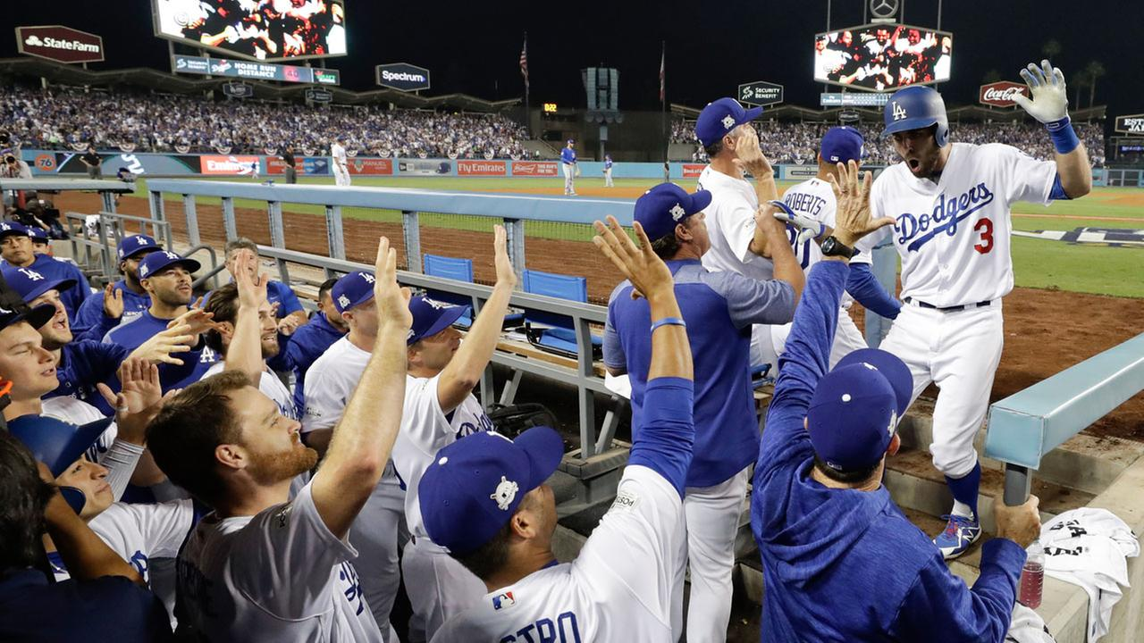 Los Angeles Dodgers Chris Taylor returns to the dugout after hitting a home run against the Chicago Cubs during Game 1 of NLCS in Los Angeles, Saturday, Oct. 14, 2017.