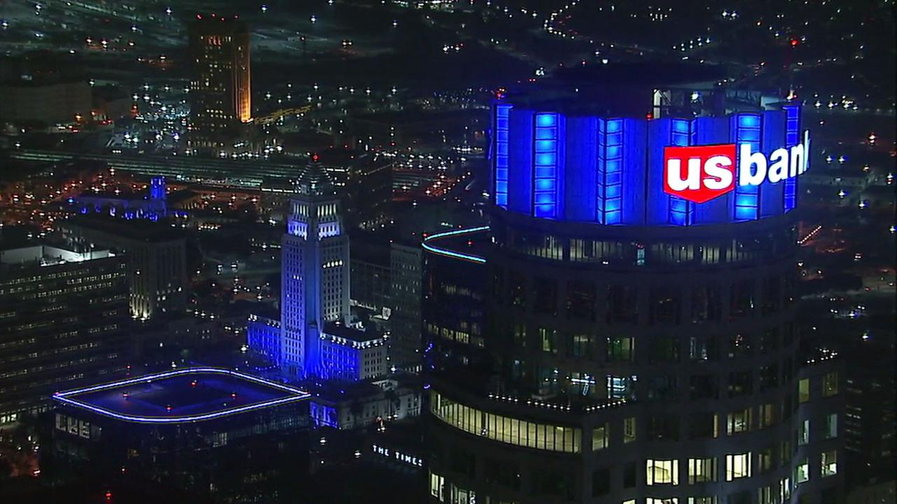 Los Angeles City Hall, the U.S. Bank building and other downtown structures lit up in Dodger Blue after the team wins the NLCS on Thursday, Oct. 19, 2017.