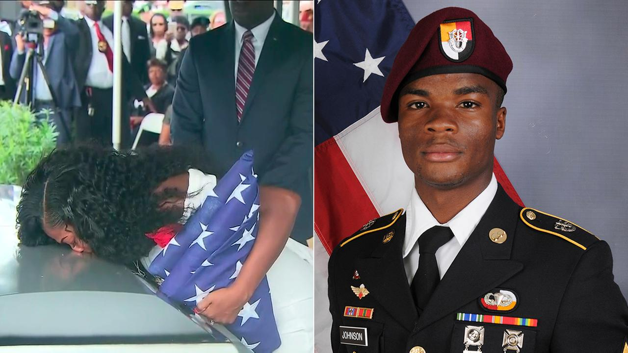 Myeshia Johnson kisses the casket of her slain husband, Army Sgt. La David Johnson, at his funeral in Cooper City, Florida, on Saturday, Oct. 21, 2017.