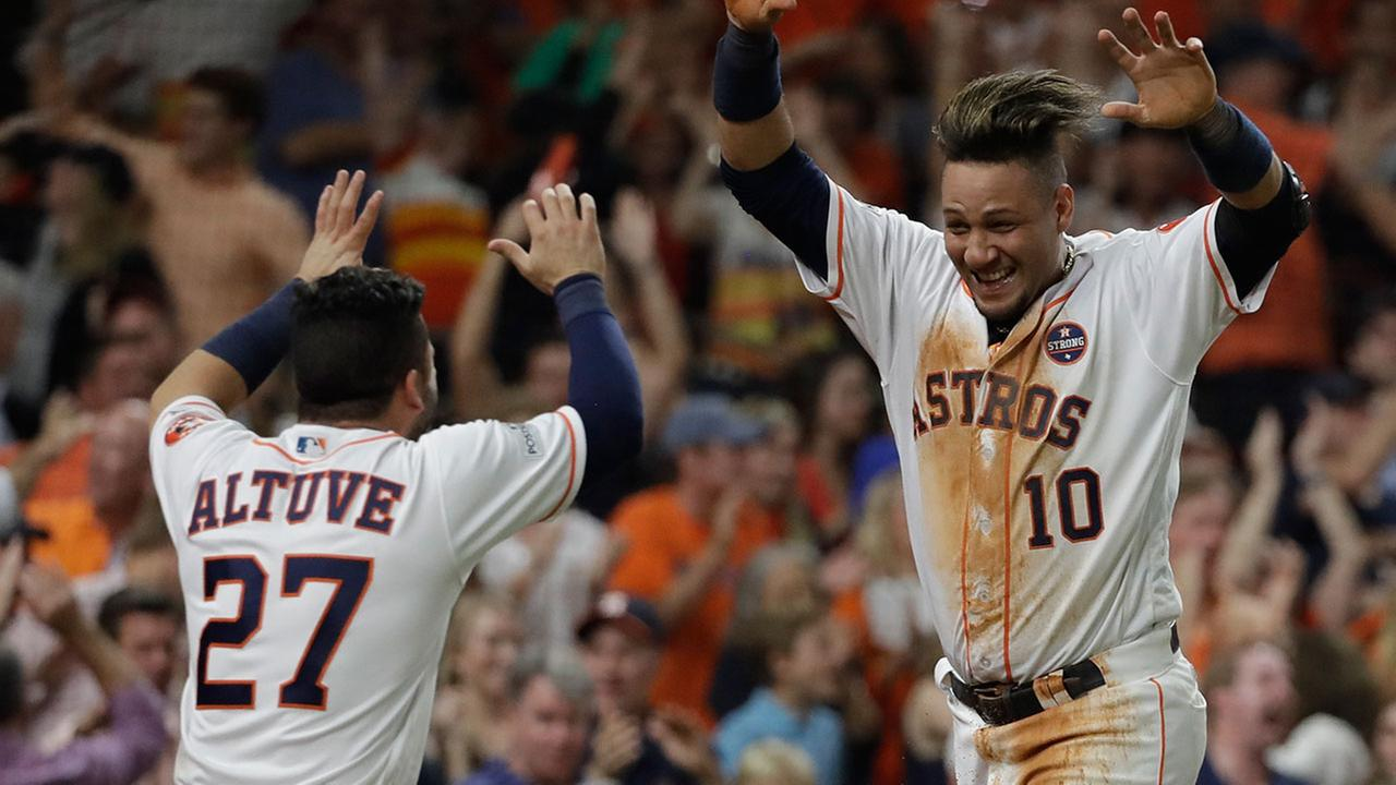 The Astros Yuli Gurriel is congratulated by teammate Jose Altuve after scoring during Game 7 of the ALCS against the New York Yankees Saturday, Oct. 21, 2017, in Houston.