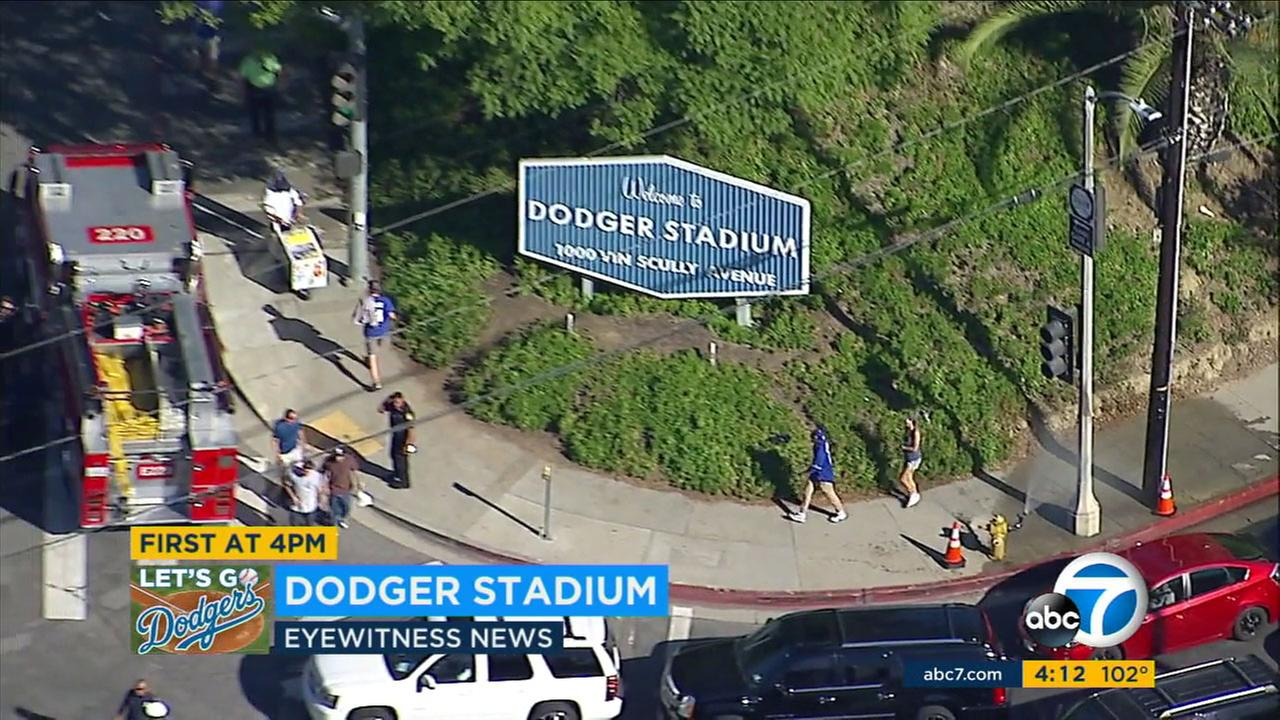 Fire hydrants were opened to spray mist on fans as police and firefighters stood by for the start of the World Series at Dodger Stadium.