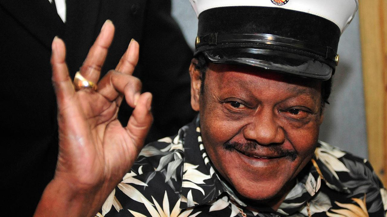 In this Nov. 5, 2008, file photo, Fats Domino waves to fans before a ceremony re-presenting two Grammy awards to replace the ones that he lost from Hurricane Katrinas flooding.