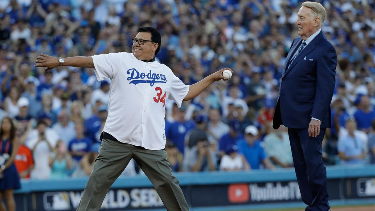 Vin Scully and Fernando Valenzuela throw out the ceremonial first pitch before Game 2 of baseballs World Series between the Houston Astros and the Los Angeles Dodgers.